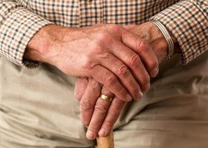 Elderly man's hands. senior living blog header