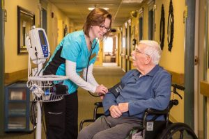 a nurse works with a resident of CCNH healthcare facilities