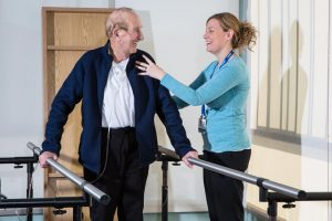 a patient receives physical therapy at a CCNH healthcare facility