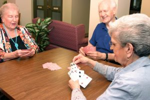 residents at st. ann rehabilitation and nursing center play cards