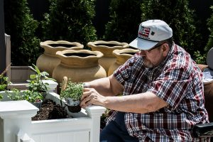 a resident of the mt. carmel rehabilitation and nusring center works in the facilies' healing garden