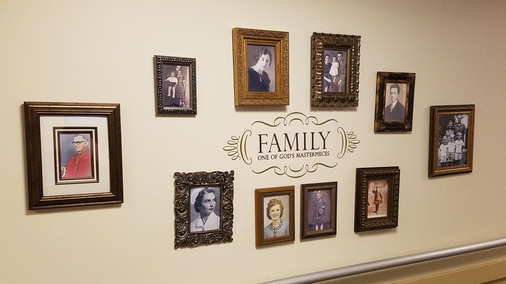 one of the family photo walls at mt.  carmel