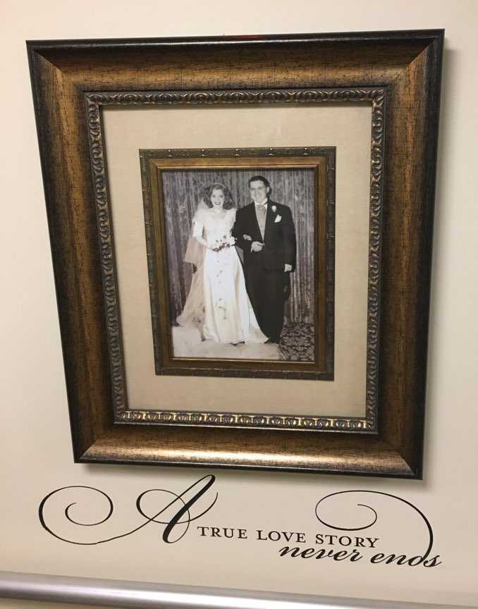 an image of a married couple on the photo wall at the mount carmel rehabilitation and nursing center
