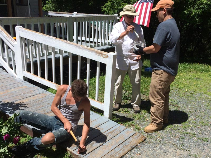 volunteers work on a home during the 2018 hand-in-hand program in the north country.