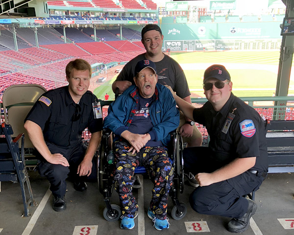 St Teresa Resident Jack with Scott and Tyler, drivers with American Medical Response (AMR) in Manchester, at Fenway Park.