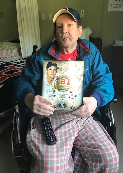 St. Teresa resident Jack with a signed photo of Red Sox player Carl Yastrzemski.