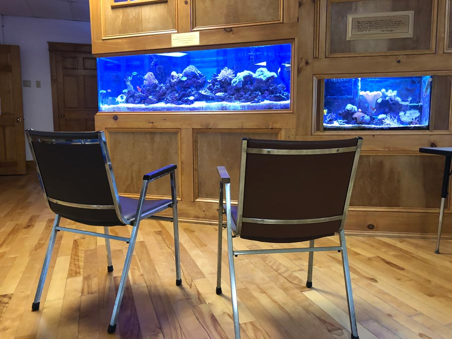 Chairs sit in front of the aquarium at the St. Charles School in Rochester NH.