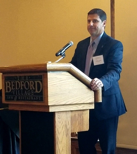 Outgoing Catholic Charities New Hampshire board member Todd Fahey speaks at the organization's 2018 Annual Meeting. Fahey was the recipient of the 'Above and Beyond' award. Fahey is state director for AARP New Hampshire.