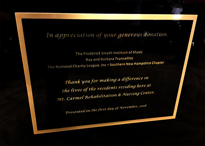 Sign recognizing the donors of the Kawai grand piano at the Mt. Carmel Rehabilitation and Nursing Center.