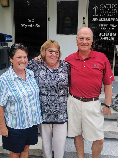 Reunited siblings Joan and Skip with Catholic Charities NH's Elaine Langton.