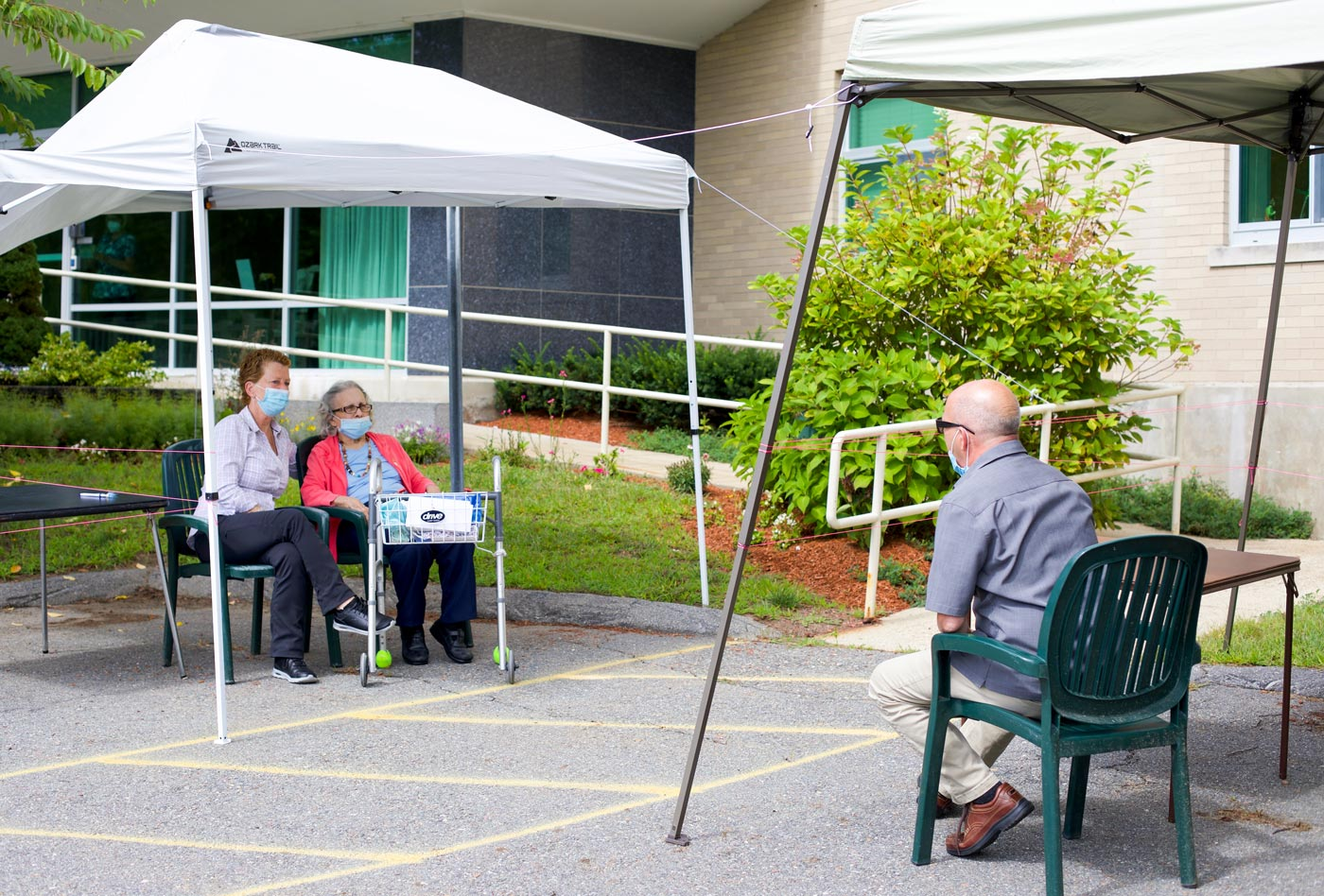 Pam Puzyn and a resident participate in an outdoor visit at the Warde Rehabilitation and Nursing Center in Windham, NH