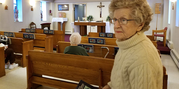 Margaret Parodi is a tenant of Bishop Primeau Senior Living Community. She is seen here attending the Rosary service at the on-site chapel.