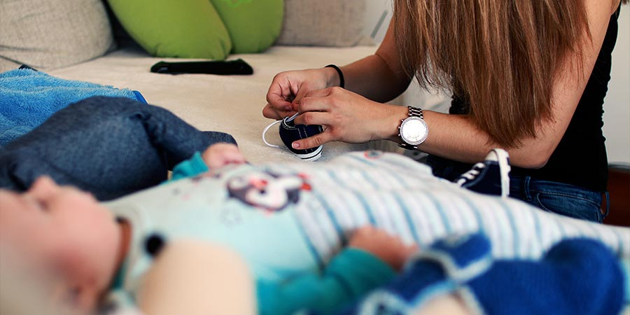 woman working on a child's shoe.
