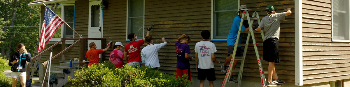 Volunteers work on a home in Bethlehem, NH as part of CCNH's Hand-in-Hand event.